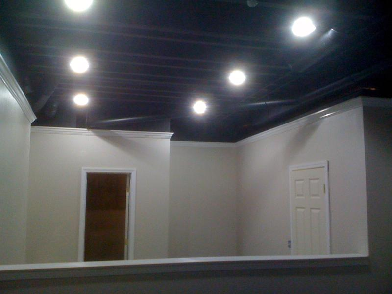 completed paintwork in a basement- crown molding