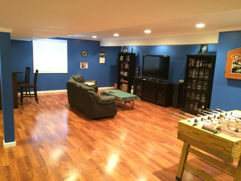 completed entertainment area of a basement in Oxford. Mi